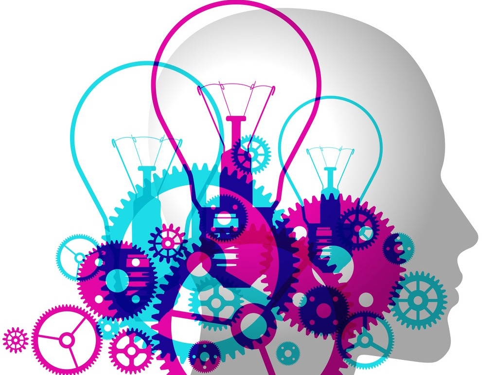 Silhouette of a head with graphics of lightbulbs and cogs inside